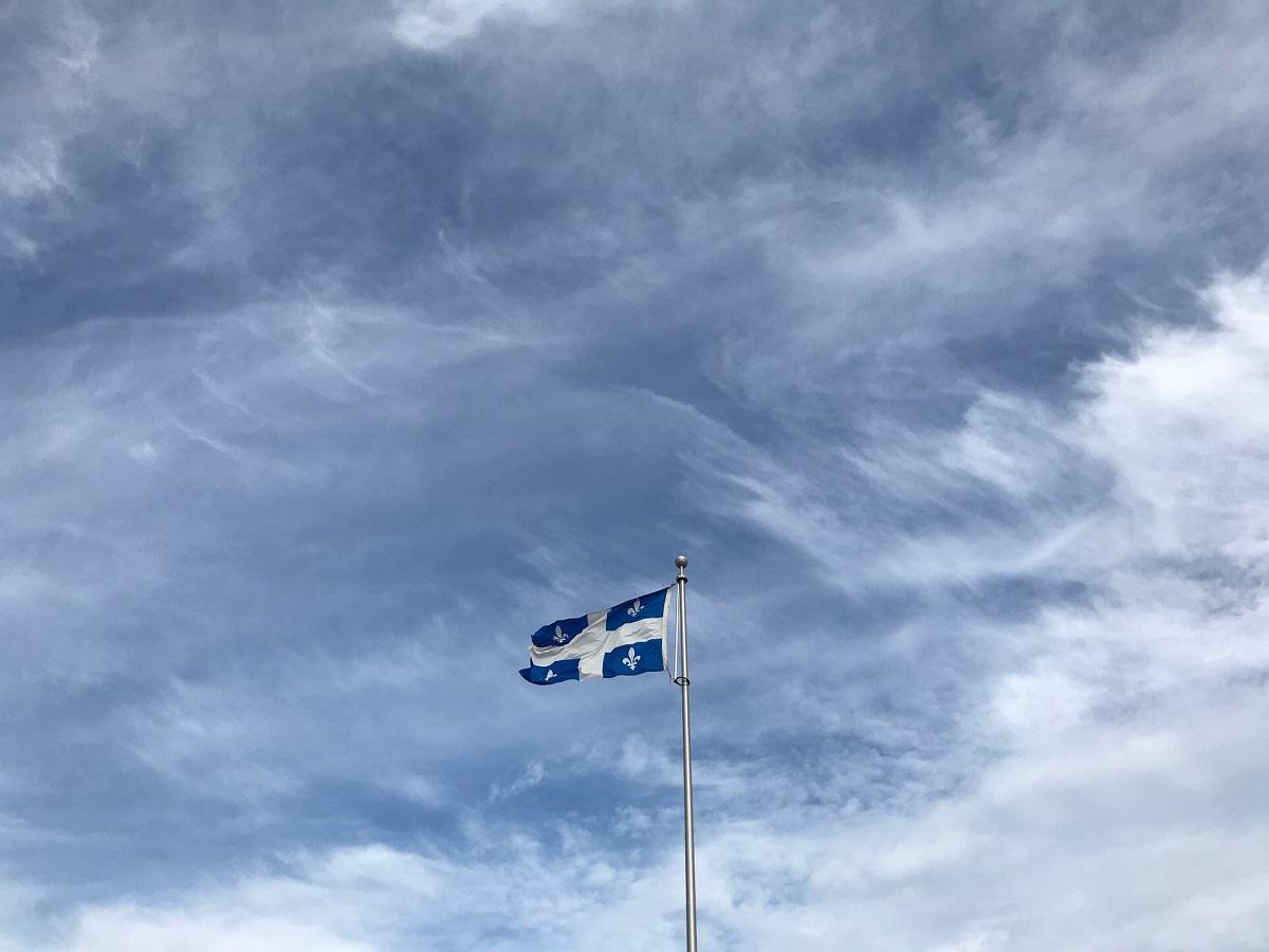 Quebec flag set against the sky