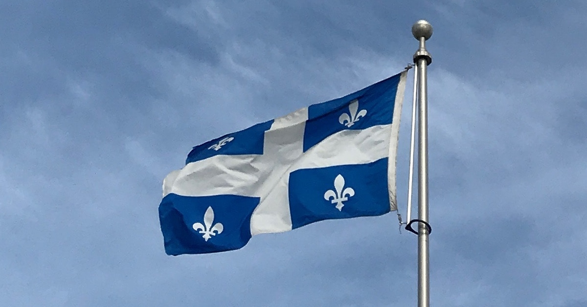 A Quebec flag flying in the sky.