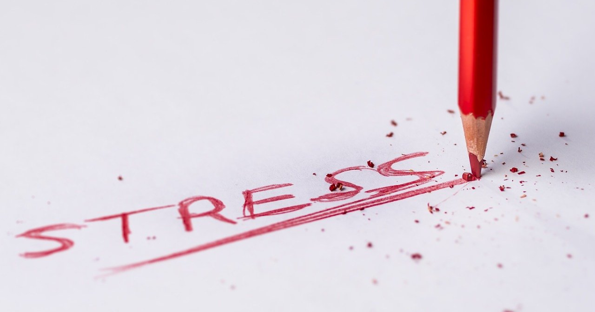 The word ''stress'' written in red on a paper sheet