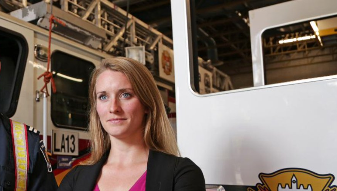 Jennifer Keir standing in front of a fire truck