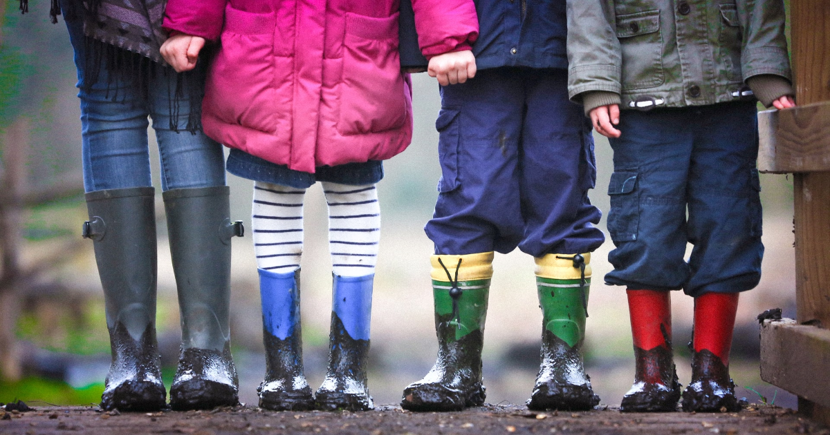 Children's legs with boots on their feet