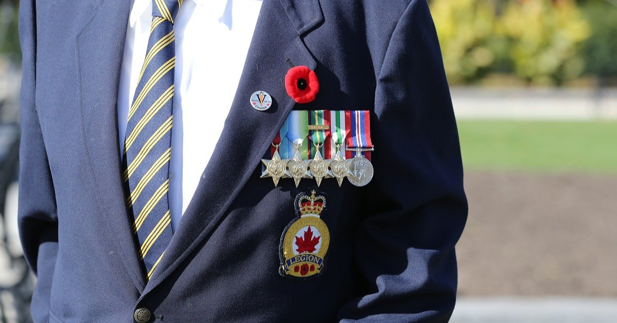 Canadian Veteran with a poppy and medals on his jacket.