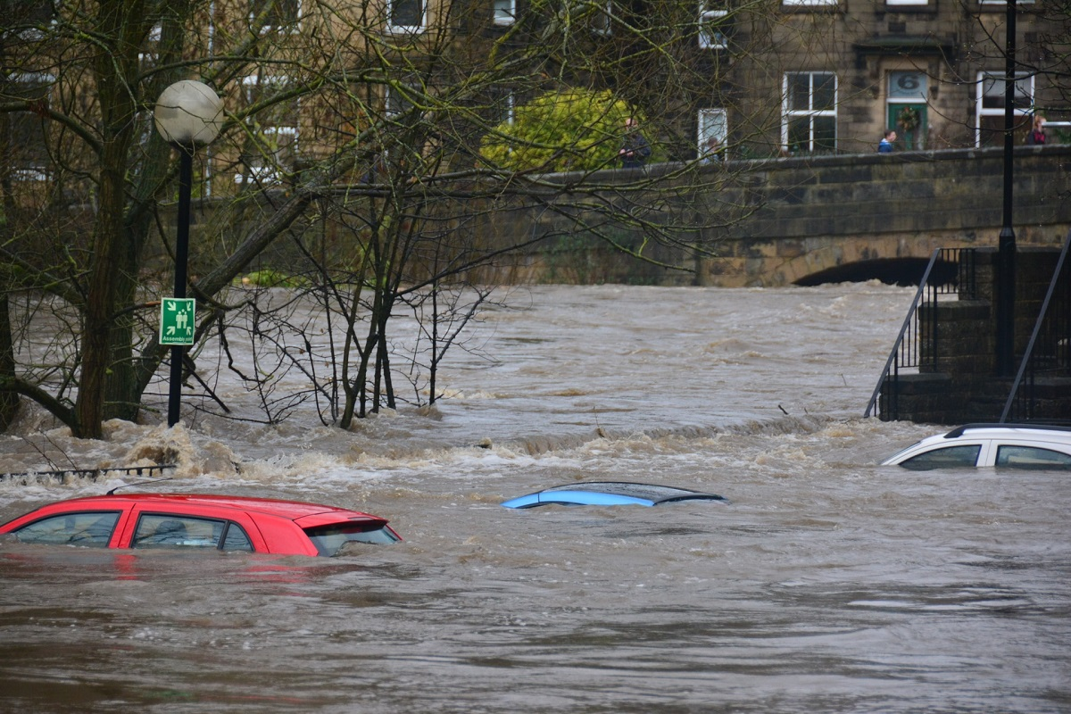 Cars submerged in water during flooding