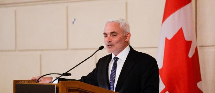 Frank Giustra at a podium