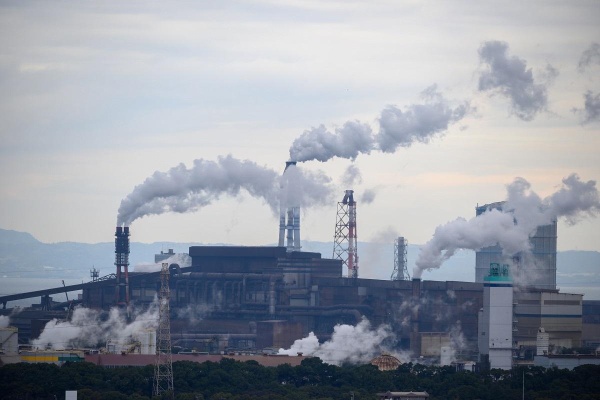 Warehouse chimney stacks emitting smoke