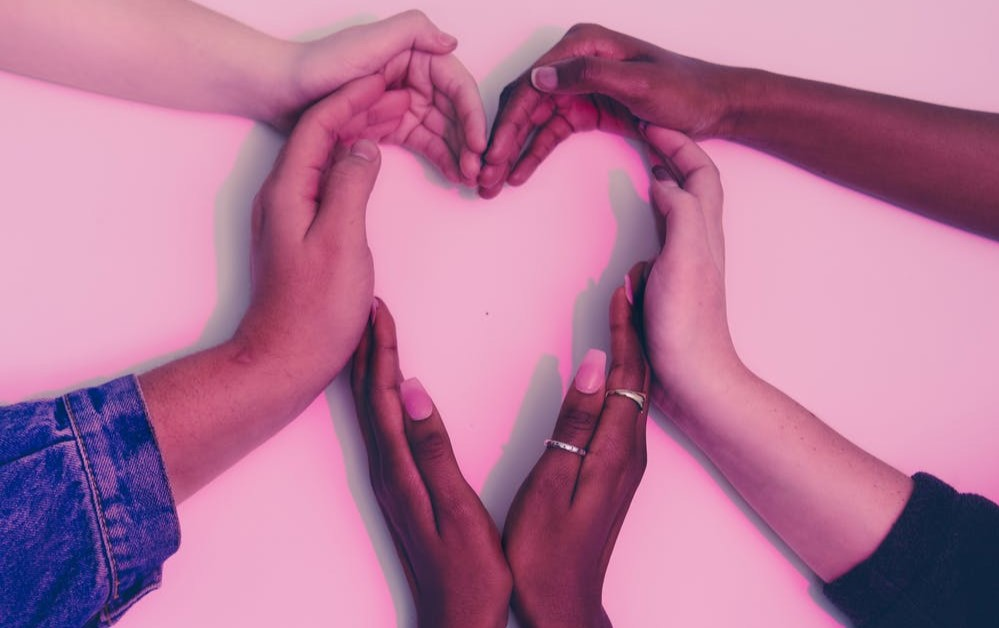 Hands forming a shape of heart