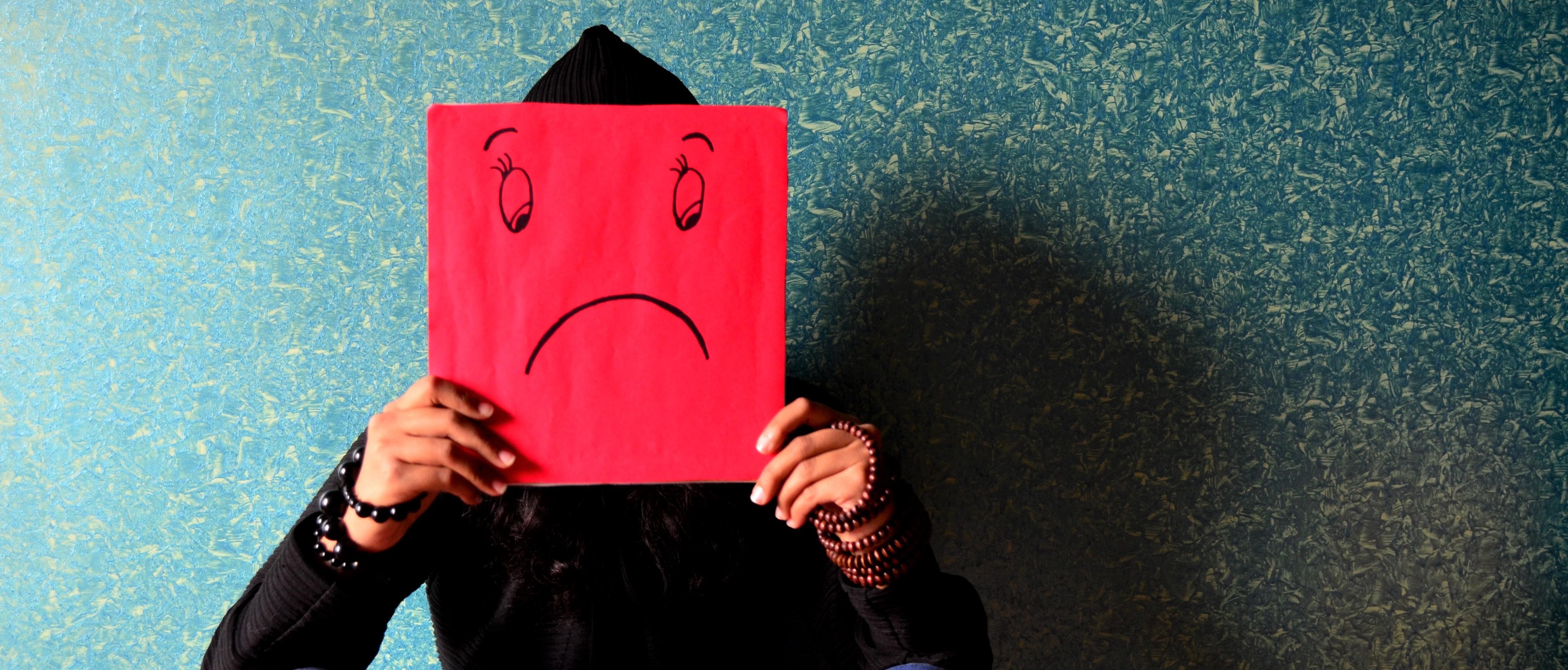 Adolescent expressing sadness.