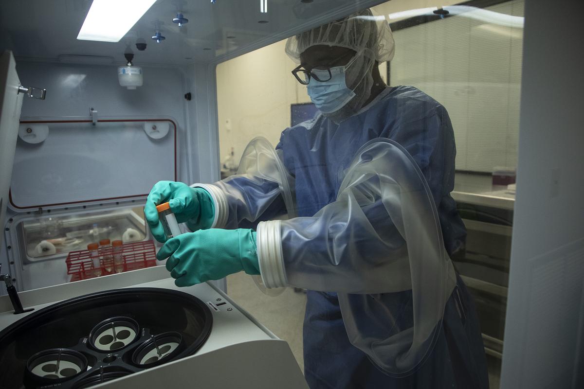 Lab worker handling vaccine