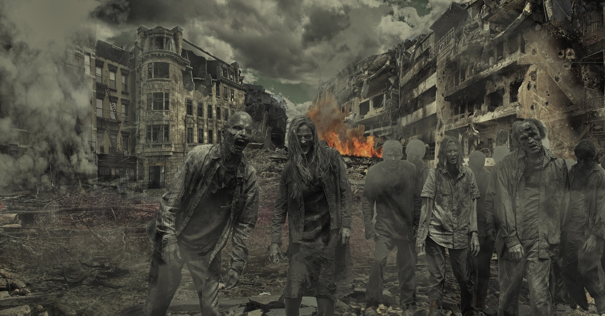 Zombies walking in a destroyed city landscape.