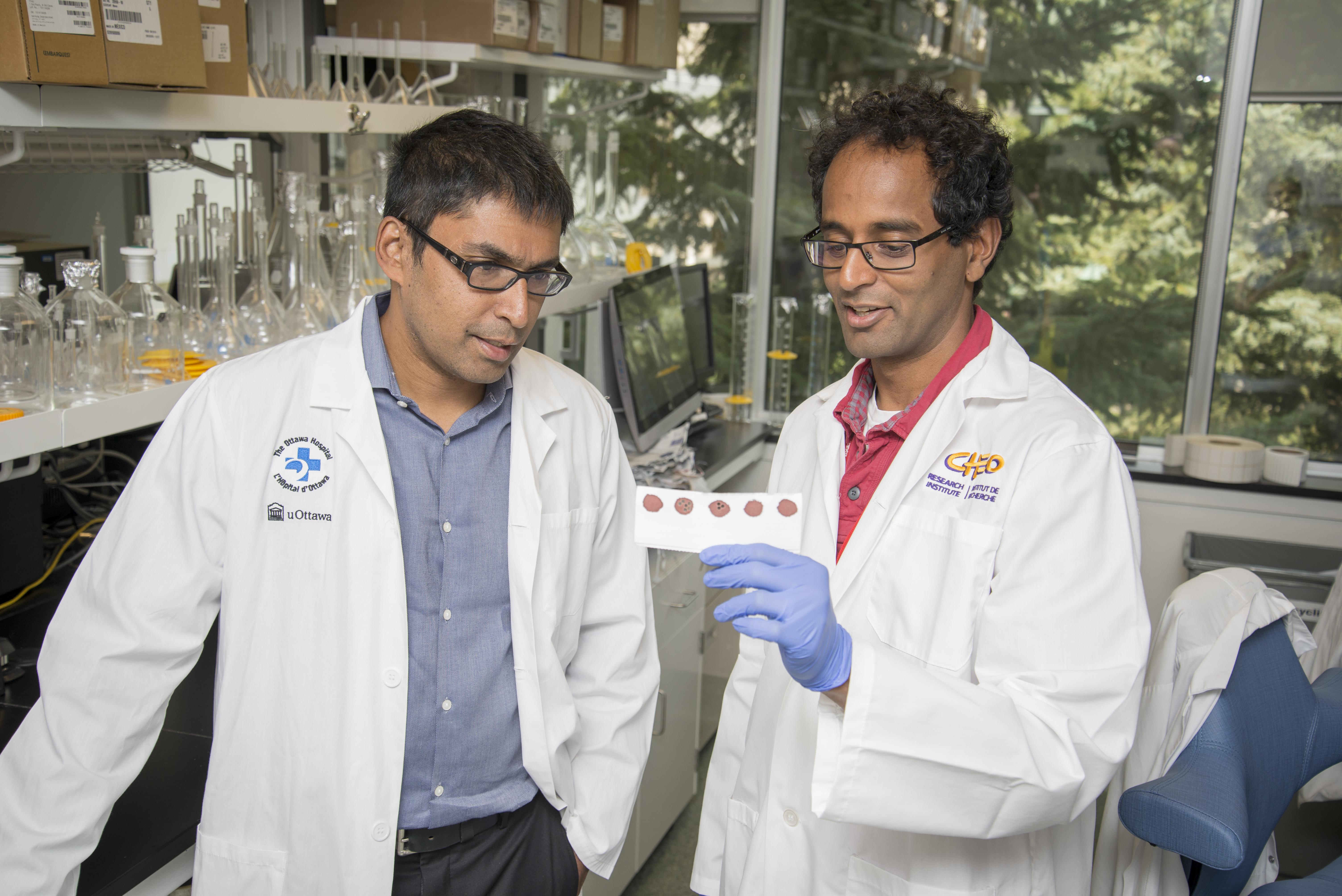 Dr. Kumanan Wilson and Dr. Pranesh Chakraborty in laboratory.