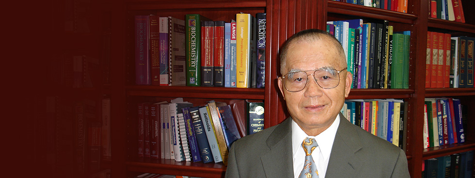 Photo of Dr. Yu in front of a bookcase